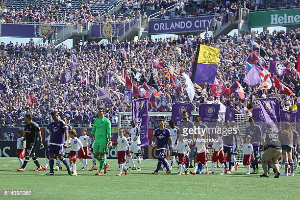 The teams enter the field of play during a MLS soccer match between Real Salt Lake and the Orlando City SC at the Orlando Citrus Bowl on March 6 2016...