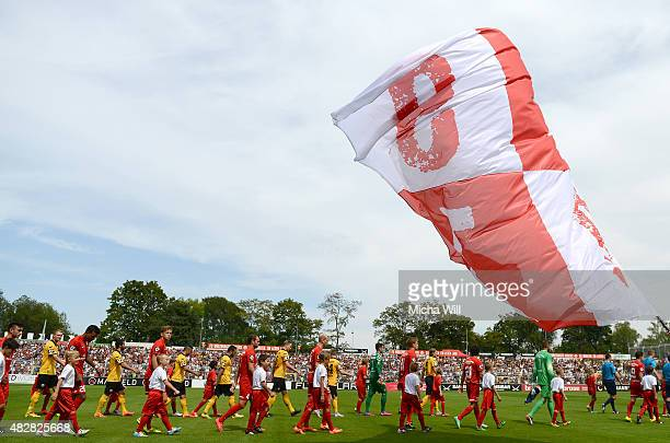 The teams enter the pitch at the beginning of the Third League match between Wuerzburger Kickers and Dynamo Dresden at flyeralarm Arena on August 1...