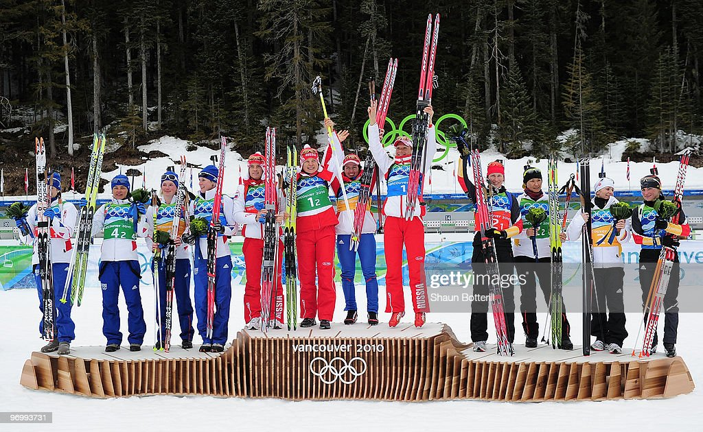 The teams from Russia (gold) France (silver) and Germany (bronze) celebrate following the women's biathlon 4 x 6km relay on day 12 of the 2010 Vancouver Winter Olympics at Whistler Olympic Park Cross-Country Stadium on February 23, 2010 in Whistler, Canada.
