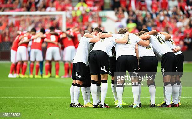 The teams gather in a huddle prior to the Sky Bet Championship match between Nottingham Forest and Derby County at City Ground on September 14 2014...
