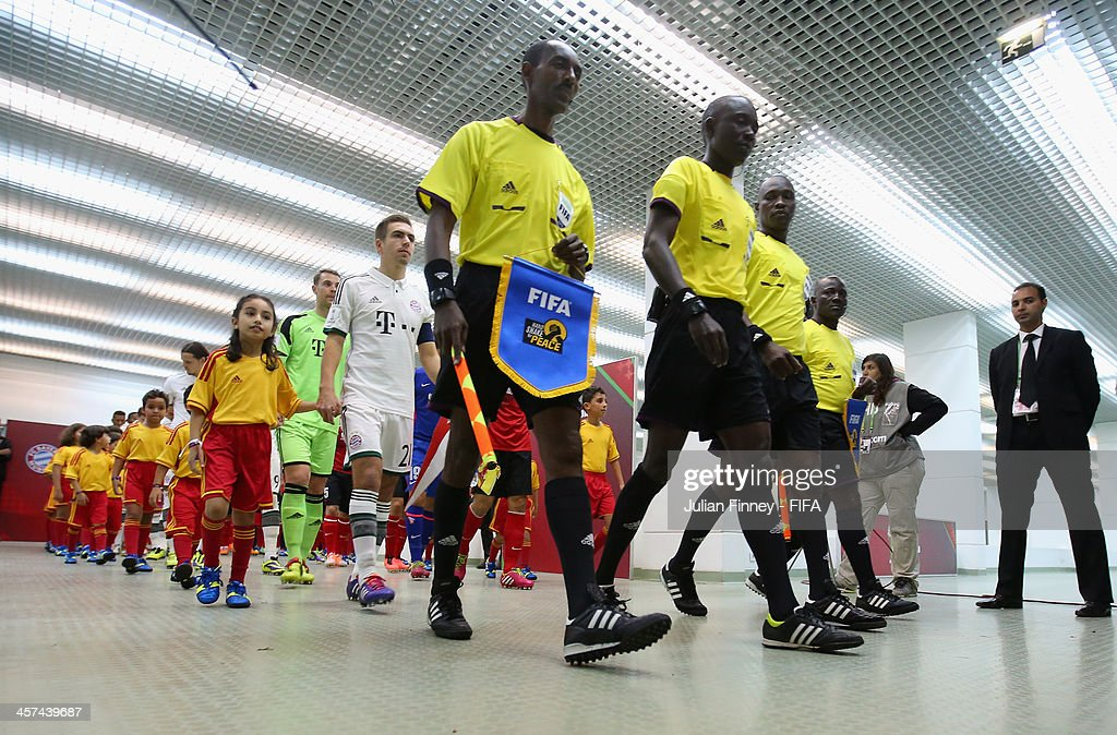 The teams in the tunnel before the FIFA Club World Cup Semi Final match between Guangzhou Evergrande FC and Bayern Muenchen at the Agadir Stadium on December 17, 2013 in Agadir, Morocco.