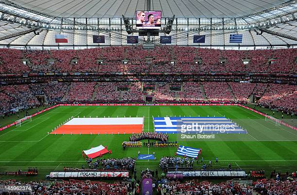 The teams line up ahead of the UEFA EURO 2012 group A match between Poland and Greece at The National Stadium on June 8 2012 in Warsaw Poland