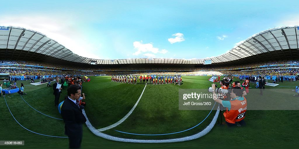 The teams line up before the 2014 FIFA World Cup Brazil Group C match between Columbia v Greece at Estadio Mineirao on June 14, 2014 in Belo Horizonte, Brazil.