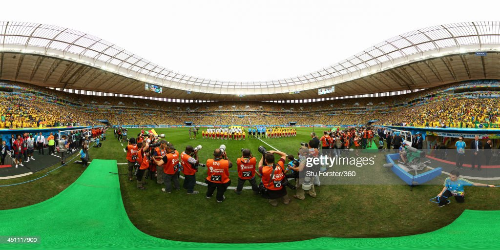 The teams line up before the 2014 FIFA World Cup Brazil Group Group A match between Cameroon v Brazil at Estadio Nacional on June 23, 2014 in Brasilia, Brazil.