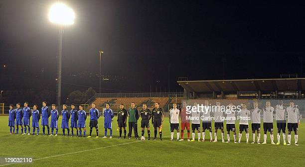 The teams line up before the beginning of the UEFA Under21 Championship match between San Marino and Germany at Stadio Olimpico on October 10 2011 in...