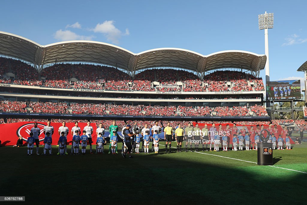 The teams line up during the 2015/16 A-League Grand Final match between Adelaide United and the Western Sydney Wanderers at Adelaide Oval on May 1, 2016 in Adelaide, Australia.