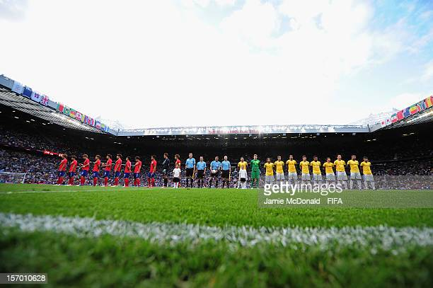 The teams line up during the Men's Football Semi Final match between Korea and Brazil on Day 11 of the London 2012 Olympic Games at Old Trafford on...