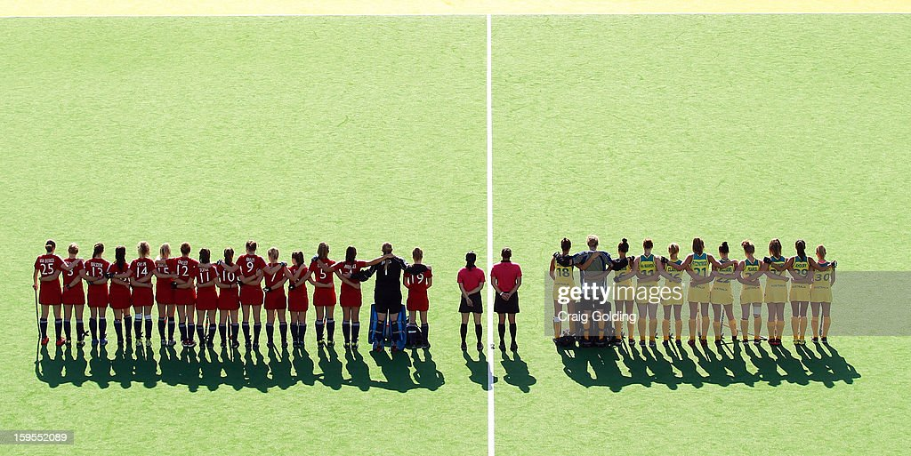 The teams line up during the national anthem before the start of the Womens Hockey match between Australia and Great Britain on day one of the 2013 Australian Youth Olympic Festival at the Hockey Centre at Sydney Olympic Park Sports Centre on January 16, 2013 in Sydney, Australia.
