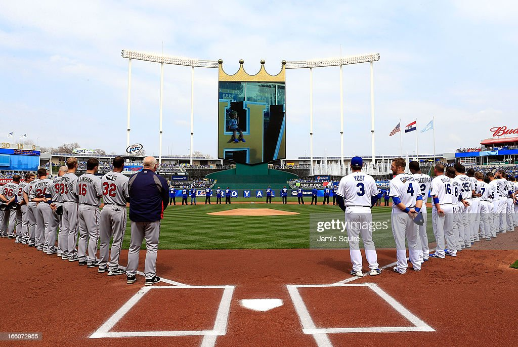 The teams line up for player introductions prior to the Kansas City Royals home opener against the Minnesota Twins at Kauffman Stadium on April 8, 2013 in Kansas City, Missouri.