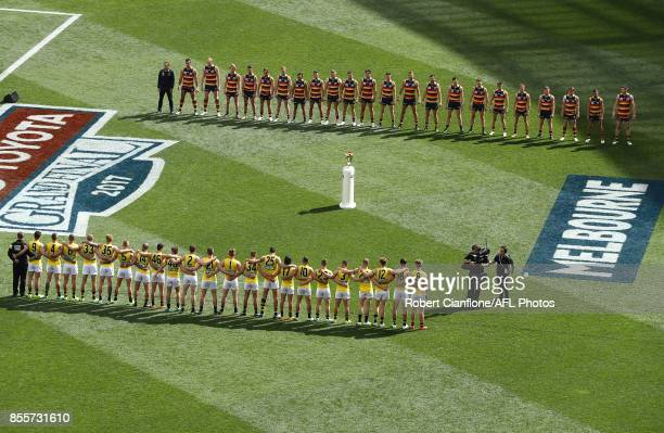 The teams line up for the 2017 AFL Grand Final match between the Adelaide Crows and the Richmond Tigers at Melbourne Cricket Ground on September 30...