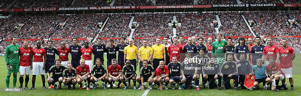 The teams line up for the MU Foundation Charity Legends match between Manchester United Legends and Real Madrid Legends at Old Trafford on June 2, 2013 in Manchester, England.