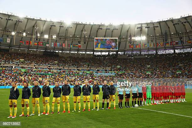 The teams line up for the national anthems before the Women's Olympic Gold Medal match between Sweden and Germany at Maracana Stadium on August 19...