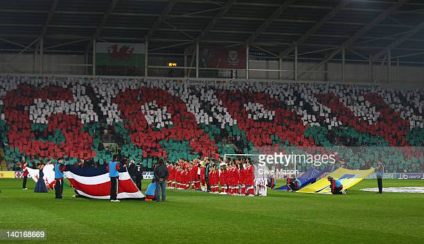 The teams line up for the national anthems during the Gary Speed Memorial International Match between Wales and Costa Rica at the Cardiff City...