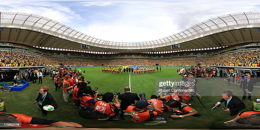 The teams line up prior to the FIFA Confederations Cup Brazil 2013 Group A match between Brazil and Japan at National Stadium on June 15, 2013 in Brasilia, Brazil.