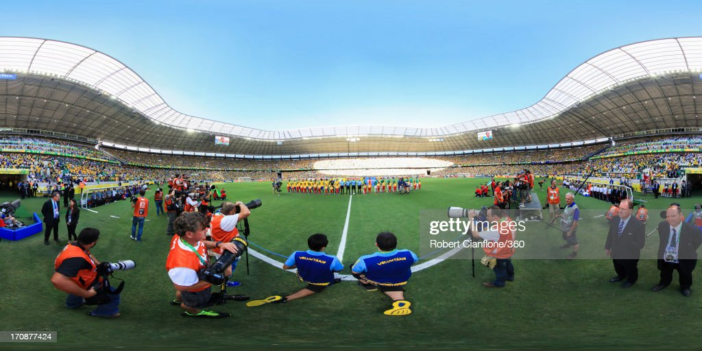 The teams line up prior to the FIFA Confederations Cup Brazil 2013 Group A match between Brazil and Mexico at Castelao on June 19, 2013 in Fortaleza, Brazil.