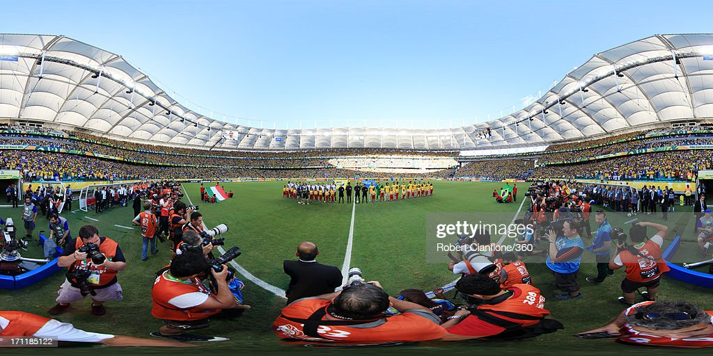 The teams line up prior to the FIFA Confederations Cup Brazil 2013 Group A match between Italy and Brazil at Estadio Octavio Mangabeira (Arena Fonte Nova Salvador) on June 22, 2013 in Salvador, Brazil.
