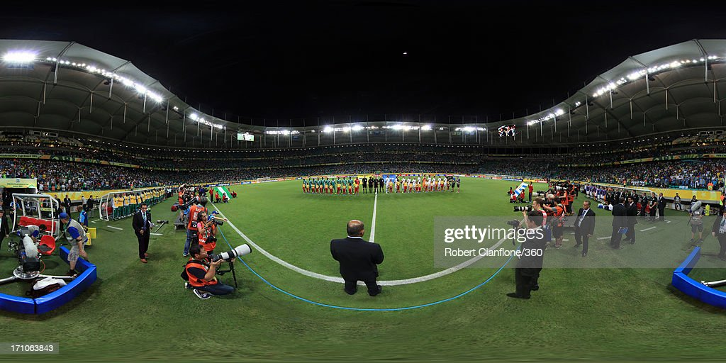 The teams line up prior to the FIFA Confederations Cup Brazil 2013 Group B match between Nigeria and Uruguay at Estadio Octavio Mangabeira (Arena Fonte Nova Salvador) on June 20, 2013 in Salvador, Brazil.