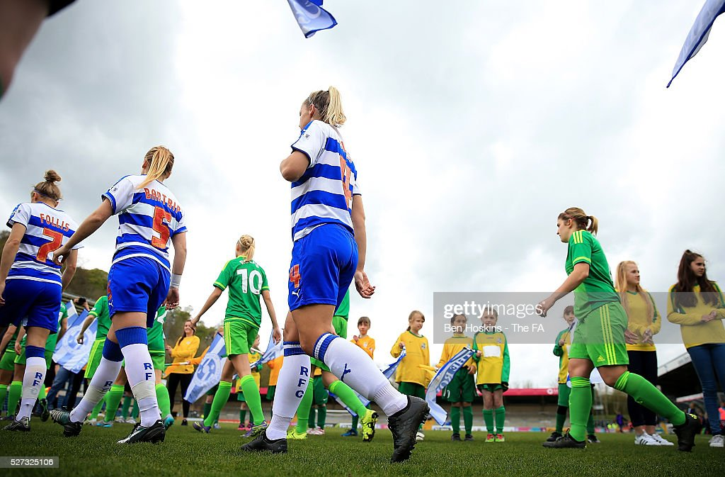 The teams make their way out on to the pitch ahead of the WSL 1 match between Reading FC Women and Sunderland AFC Ladies on May 2, 2016 in High Wycombe, England.