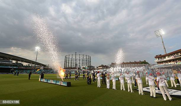 The teams make their way out onto the pitch during the Natwest T20 Blast match between Surrey and Glamorgan at The Kia Oval on May 26 2016 in London...