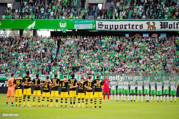 The teams observe a minute of silence for the victims of the Barcelona attack prior to kick off for the German First division Bundesliga football...