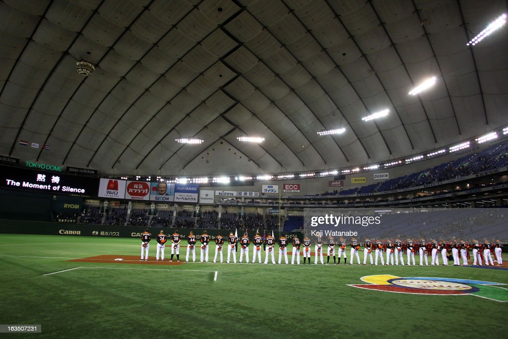 The teams observe a moment of silence to commemorate the second anniversary of the 2011 earthquake and subsequent tsunami prior to the World Baseball Classic Second Round Pool 1 game between Cuba and the Netherlands at Tokyo Dome on March 11, 2013 in Tokyo, Japan.
