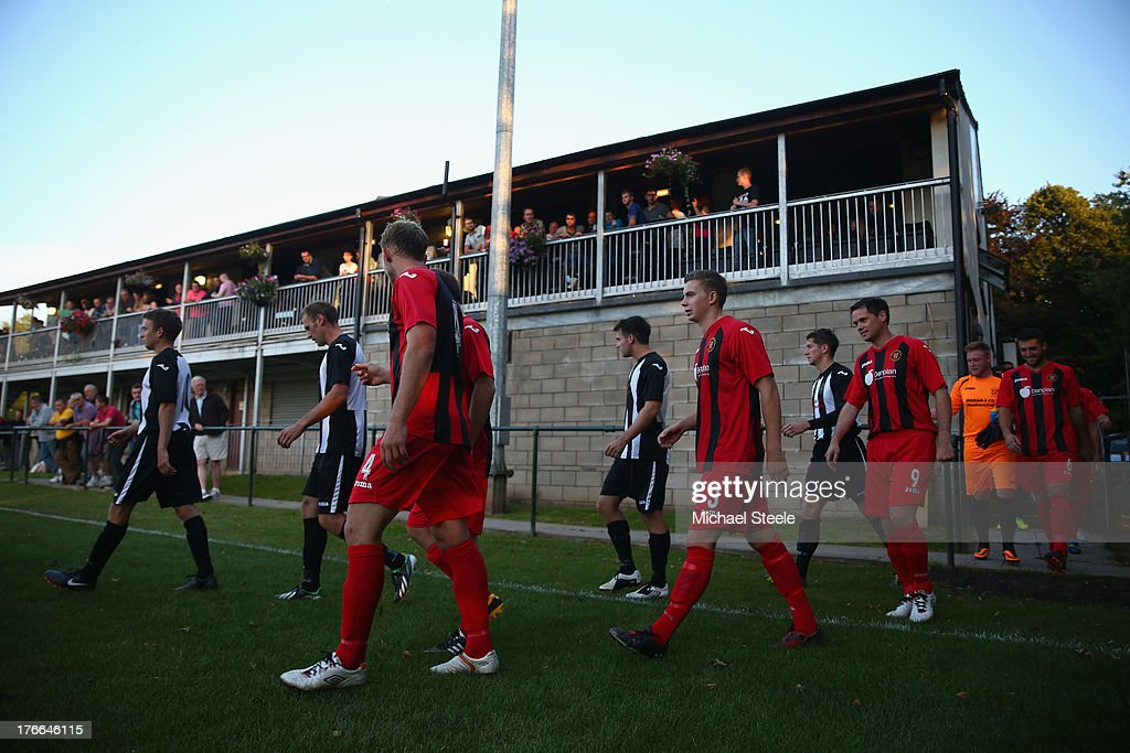The teams of Alresford Town and Winchester City take to the pitch during the FA Cup Extra Preliminary Round match between Alresford Town and Winchester City at Alrebury Park on August 16, 2013 in New Alresford, England.