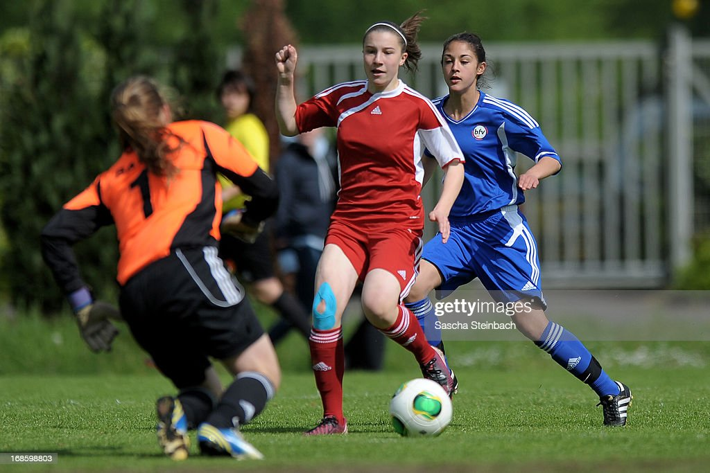 The teams of Baden and Brandenburg battle for the ball during the U15 Federal Cup of the German Football Association DFB at Sports Academy Wedau on May 12, 2013 in Duisburg, Germany.