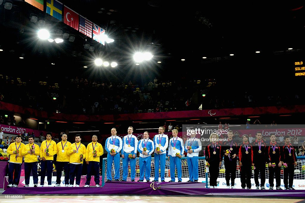 The teams of Brazil, Finland and Turkey pose on the podium after the Men's Team Goalball finals on day 9 of the London 2012 Paralympic Games at The Copper Box on September 7, 2012 in London, England.