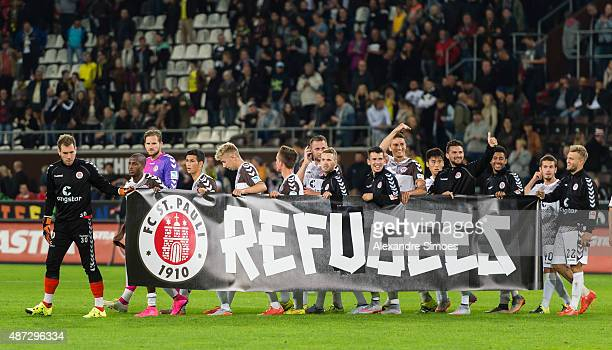 The teams of FC St Pauli and Borussia Dortmund welcome refugees during the friendly match between FC St Pauli and Borussia Dortmund at...