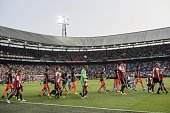 the teams of Feyenoord and Valencia CF enter the pitch during the preseason friendly match between Feyenoord and Valencia on July 23 2016 at the Kuip...