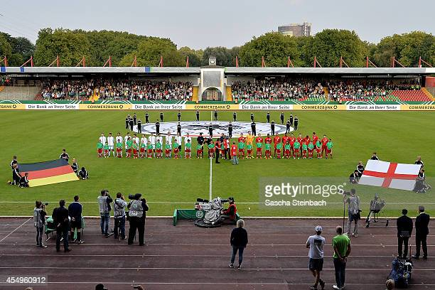 The teams of Germany and England line up for national anthems prior to the international friendly match between U19 Germany and U19 England at...