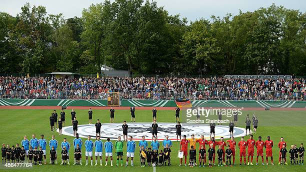 The teams of Germany and England line up for national anthems prior to the U19 international friendly match between Germany and England on September...