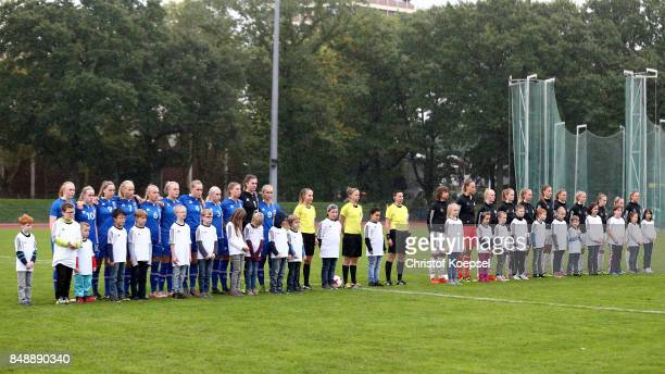 The teams of Iceland and of Germany stand for thje nationa anthems prior to the UEFA Under19 Women's Euro Qualifier match between Germany and Iceland...