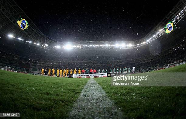 The teams of Palmeiras and Rosario lines up during a match between Palmeiras and Rosario as part of Group 2 of Copa Bridgestone Libertadores at...