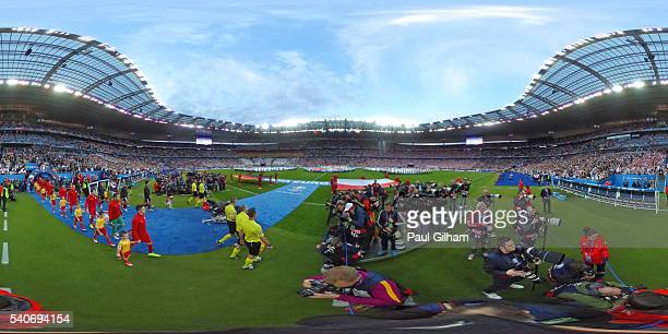The teams of Poland and Germany head on to the pitch for the UEFA EURO 2016 Group C match between Germany and Poland at Stade de France on June 16...