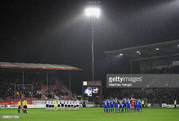 The teams of Sandhausen and Karlsruhe observe a minutes silence in memory of the victims of the Paris terror attacks last Friday prior to the Second...