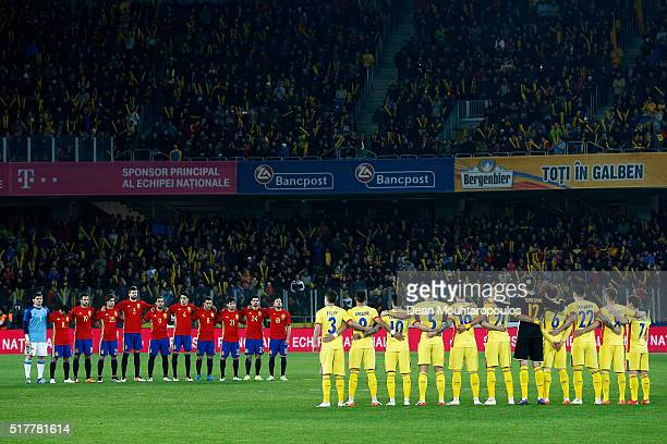 The teams of Spain and Romania stop for a minute's silence to remember Johan Cruyff of Netherlands prior to the International Friendly match between...