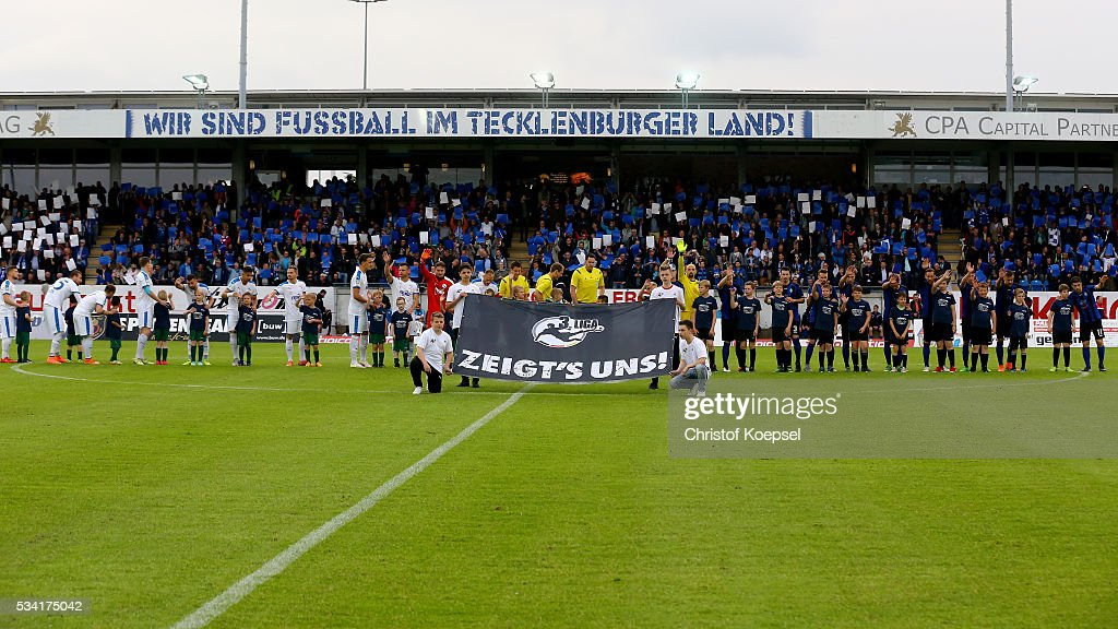 The teams of Sportfreunde Lotte and of Mannheim enter the pitch prior to the Third League play-off first leg match between SF Lotte and Waldhof Mannheim at Sportpark am Lotter Kreuz on May 25, 2016 in Lotte, Germany.