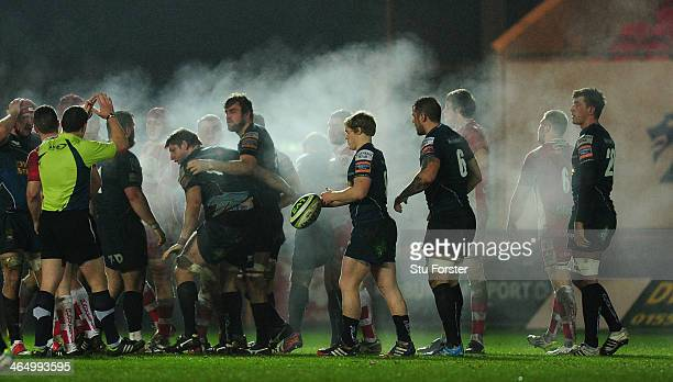 The teams prepare to scrum admist the steam during the LV= Cup match between Scarlets and Gloucester Rugby at Parc y Scarlets on January 24 2014 in...