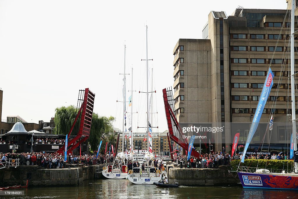The teams sail out of St Katherine's docks and towards Tower Bridge at the start of the Clipper Round The World Yacht Race at Tower Bridge on September 1, 2013 in London, England.