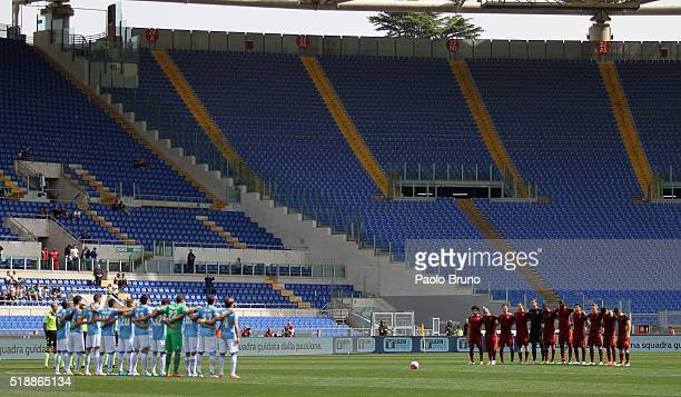 The teams stand for a minute of silence in memory of the death of former Italian player Cesare Maldini before the Serie A match between SS Lazio and...