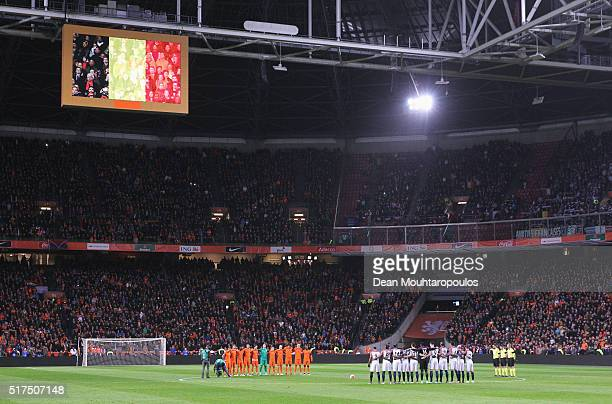 The teams stand for a minute's silence to remember those who lost their lives in the Brussels terror attacks during the International Friendly match...