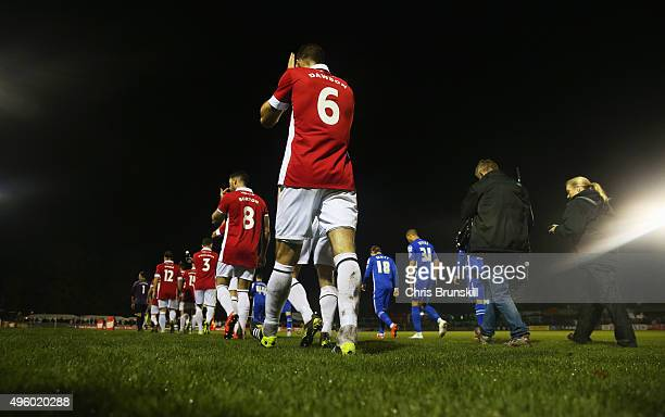 The teams walk onto the pitch prior to the Emirates FA Cup first round match between Salford City and Notts County at Moor Lane on November 6 2015 in...