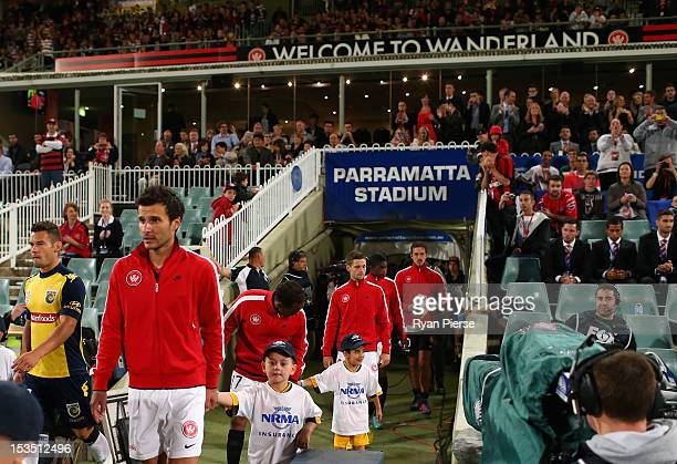 The teams walk out before the round one ALeague match between the Western Sydney Wanderers FC and the Central Coast Mariners at Parramatta Stadium on...