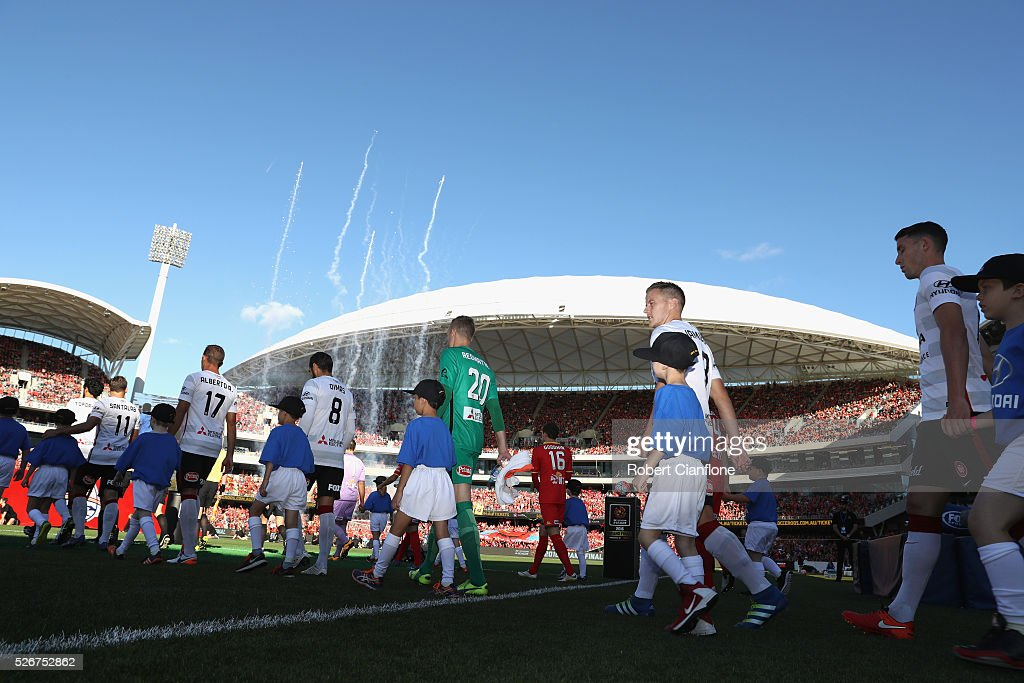 The teams walk out during the 2015/16 A-League Grand Final match between Adelaide United and the Western Sydney Wanderers at Adelaide Oval on May 1, 2016 in Adelaide, Australia.