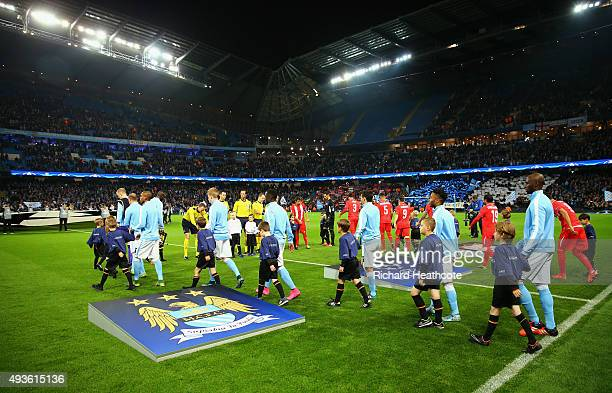 The teams walk out during the UEFA Champions League Group D match between Manchester City and Sevilla at Etihad Stadium on October 21 2015 in...