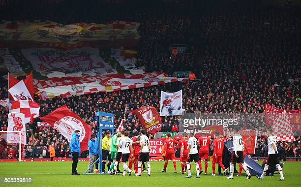The teams walk out for the Barclays Premier League match between Liverpool and Manchester United at Anfield on January 17 2016 in Liverpool England