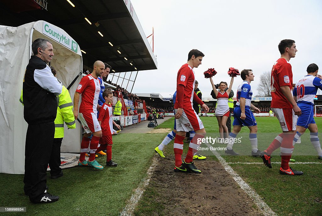 The teams walk out of the tunnel during the FA Cup with Budweiser Third Round match between Crawley Town and Reading at Broadfield Stadium on January 5, 2013 in Crawley, West Sussex.