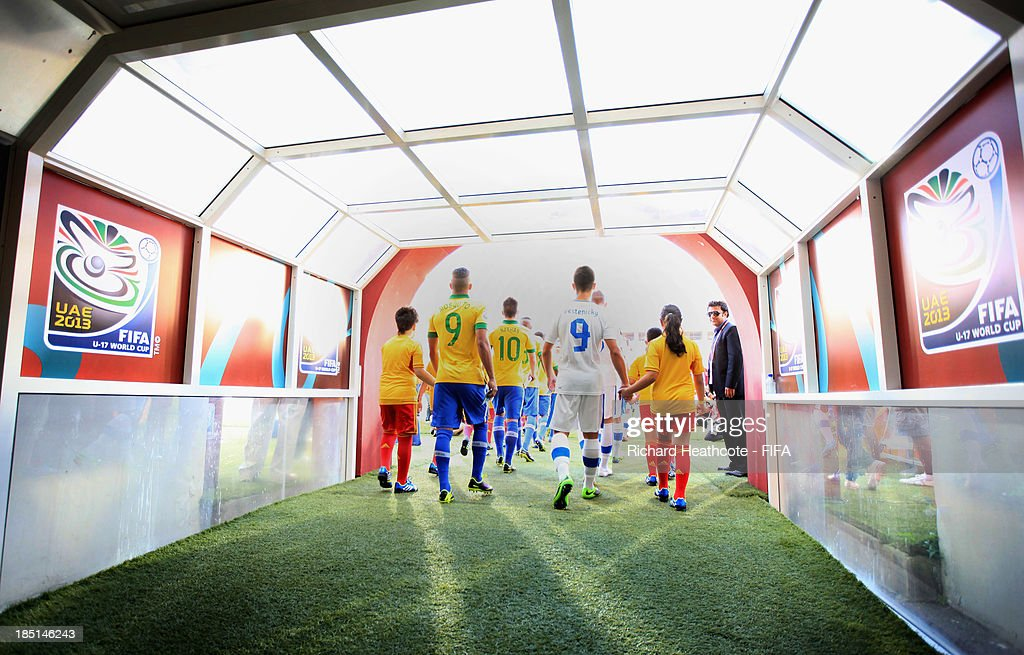 The teams walk out of the tunnel during the FIFA U-17 World Cup UAE 2013 group A match between Brazil and Slovakia at the Mohamed Bin Zayed Stadium on October 17, 2013 in Abu Dhabi, United Arab Emirates.