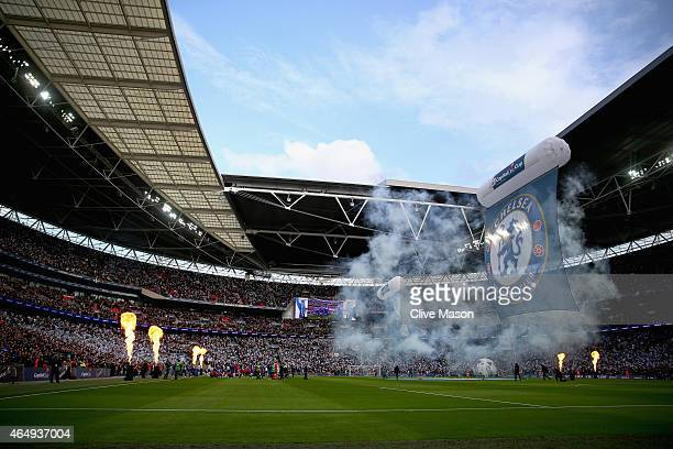 The teams walk out on to the pitch for the Capital One Cup Final match between Chelsea and Tottenham Hotspur at Wembley Stadium on March 1 2015 in...